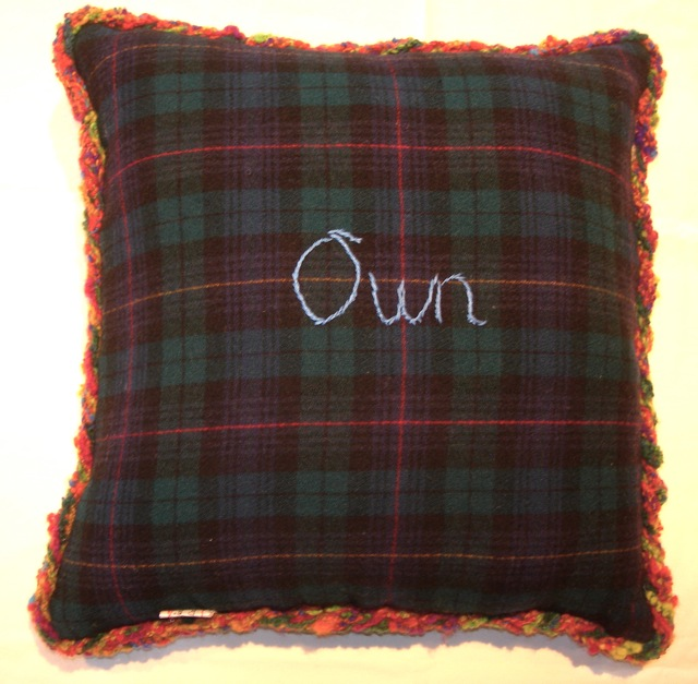 The back of my pillow with my key word in embroidery.