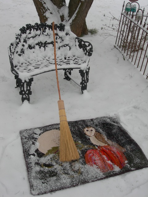 Flip the rug over and admire the beautiful snow on it!  Start sweeping the snow off.