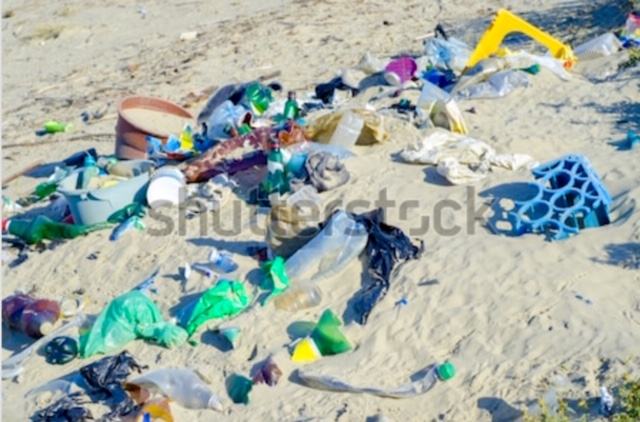 A Shutterstock image of beach litter.  It makes me sad and mad to see this.