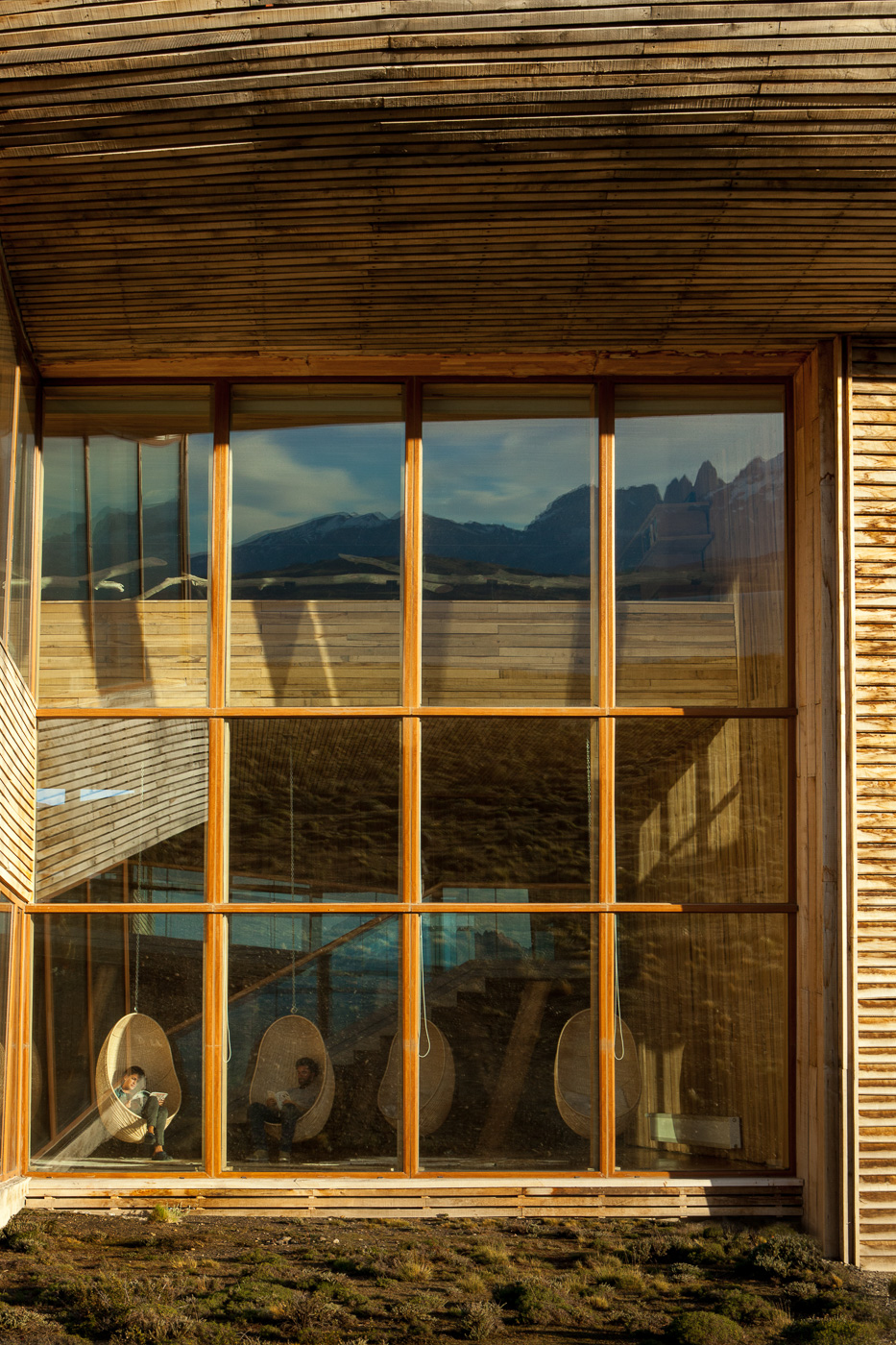 Tierra Patagonia-indoor relaxation area with hanging chairs.jpg