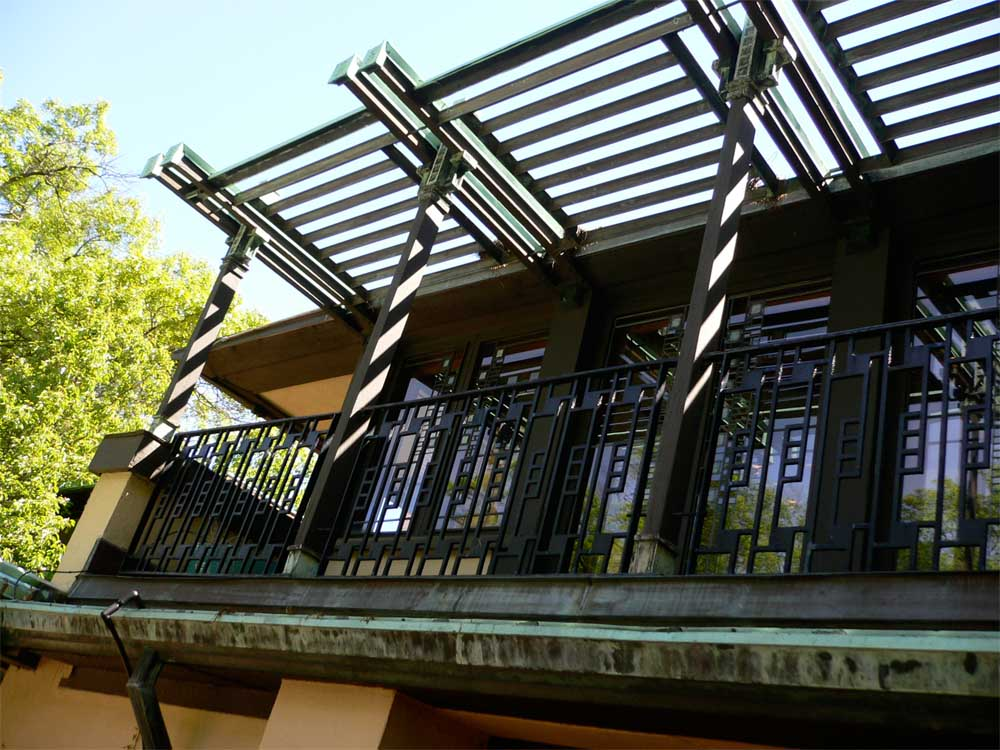 The upper trellis sits above the terrace outside the main living room. One of Wright's innovations in this house was to raise the living areas above the ground level, exploiting the views out to the wider landscape.