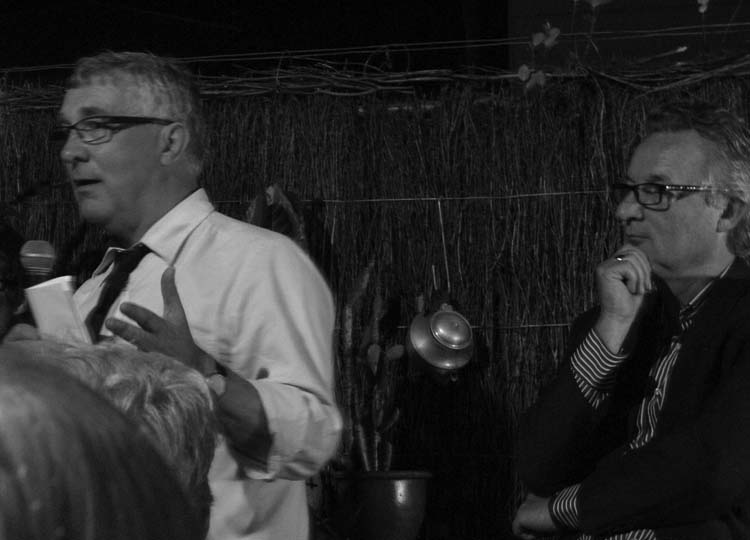 """And it's good night from me..."". Malcolm Middleton, Queensland State Government Architect, moments before he smashed a bottle of Cristal across Future Park to send her on her way. Mark Fuller, landscape architect, architect, artist, gentleman farmer, and captivating speaker looks on encouragingly. Or is he just wondering ""Now where did I hang my teapot?"""