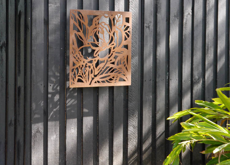 Nicole designed the weathered steel panel that marks the entry door.