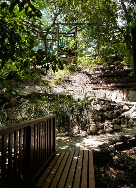 After crossing this bridge the path leads up to a play area that includes a flying fox.