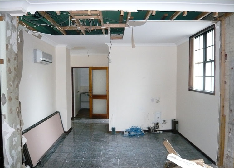Looking in the same direction as the first image, this shows the space as it was at the very start of the project.