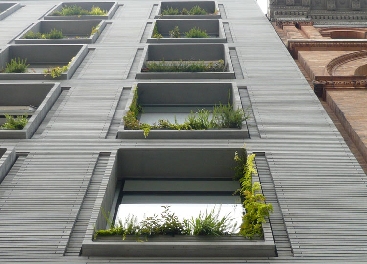 This building has a garden in every window.