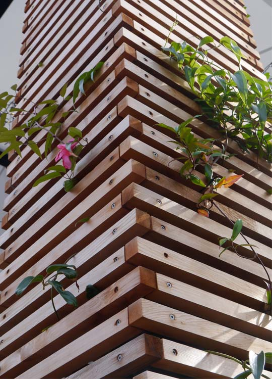 ...allowing free-standing vertical gardens to act as markers and be visually engaging both with and without planting.