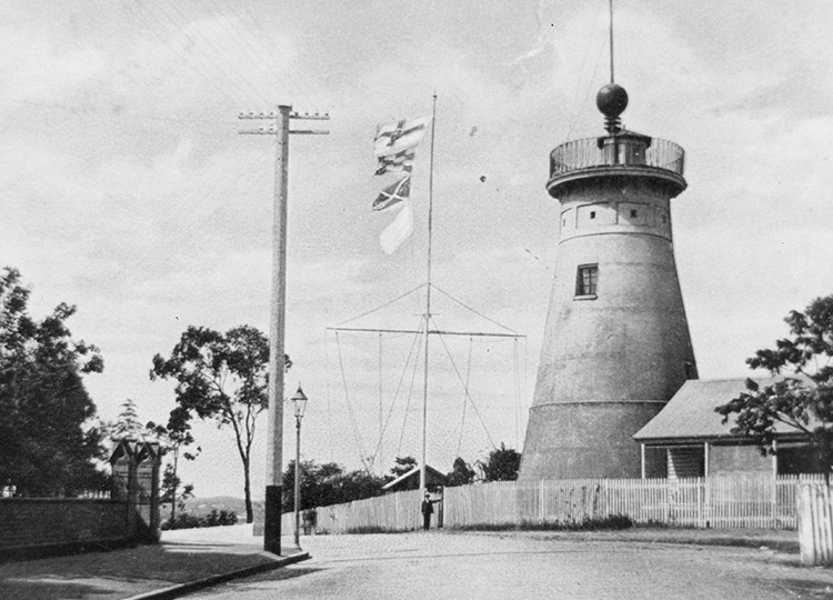 The time ball at the top of the tower and signal flags on the flagstaff in 1908.  Image: State Library of Queensland .