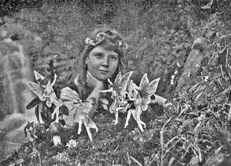 Frances Griffith in the garden with fairy visitors. Image: Science & Society Picture Library
