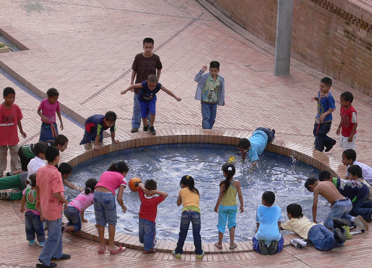 Children playing outside the new Moravia Community Centre, Medellin.