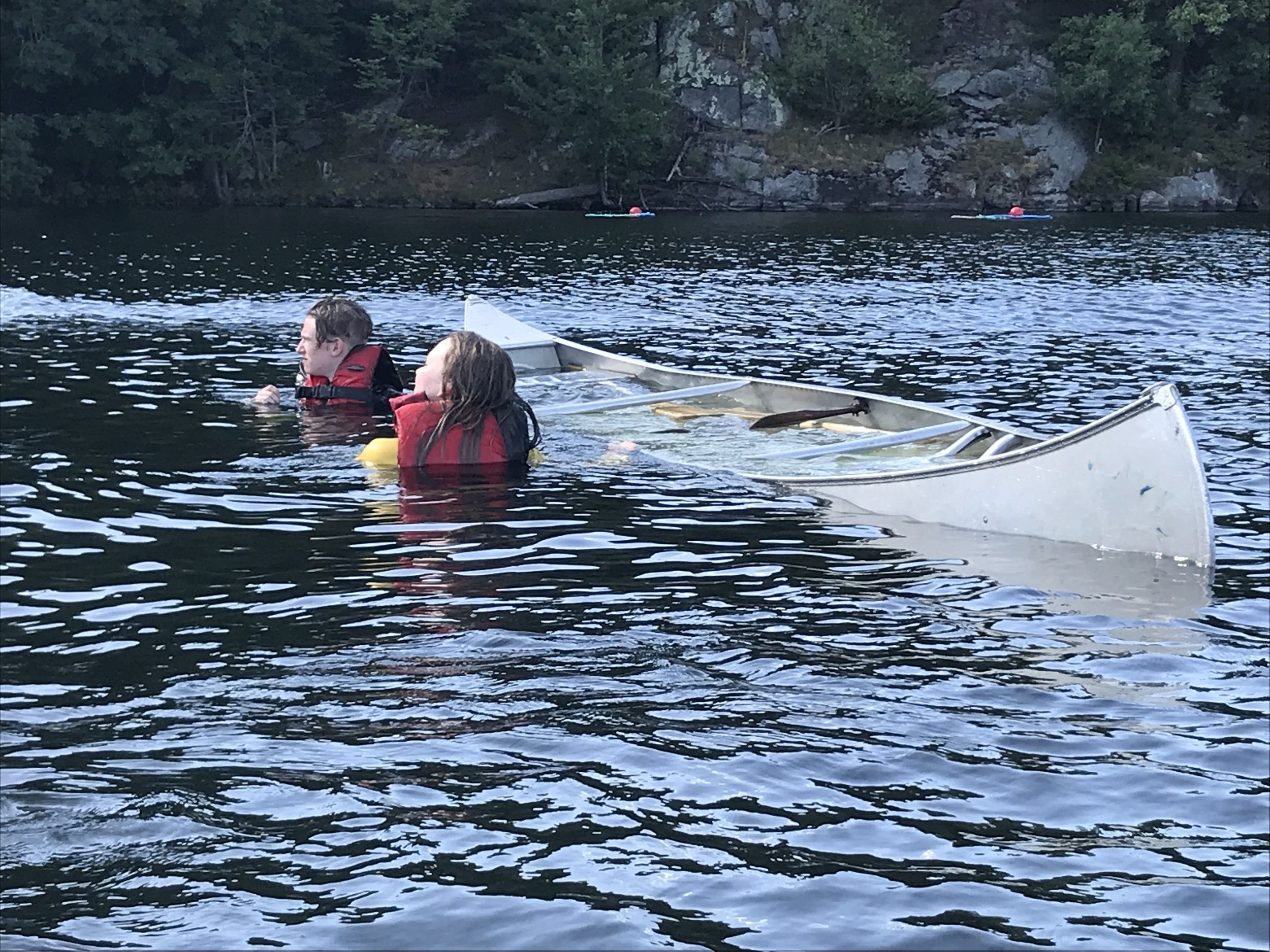 learning self rescue and how to empty a canoe while in the middle of the lake. Tons of fun! part of our safe paddling certificate.