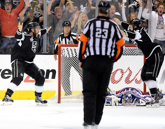 Alec Martinez, teammate, and the LA Fans go crazy after Martinez scored the game winning goal in double OT to capture the Cup while Henry Lundqvist laid in agony.Pictures are truly worth a thousand words. (Getty Images)