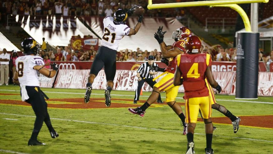 ASU's Jalen Strong (21) snagged the game winning catch out of the air thanks to some disgraceful coverage by the USC secondary. This is greatest way to cap off the type of game Strong had. (AP Photo)
