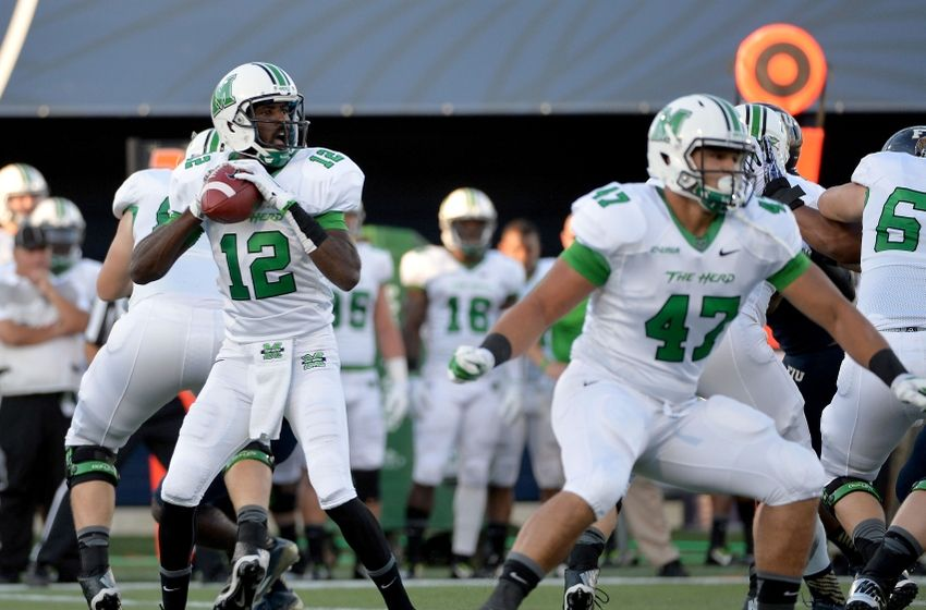 Rakeem Cato set a new NCAA record against Florida International, throwing a touchdown pass in 39 straight games. The senior out of Miami has 25 total TDs on the season, leading the Thundering Herd to a 7-0 record. If you ever get a chance, check him out. (AP Photo)