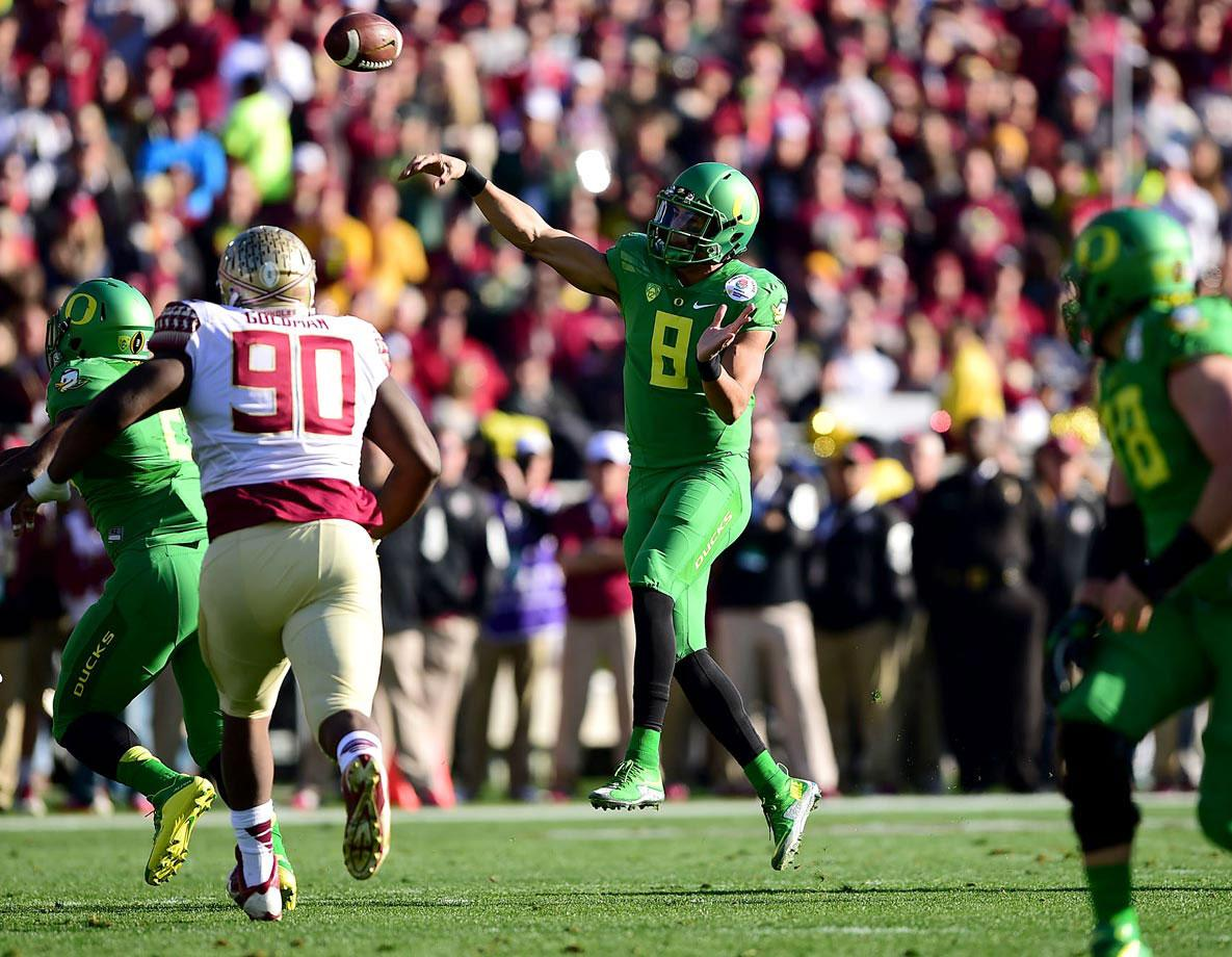 It takes Oregon 10 seconds to get the play in from the pressbox, down to the field, and to Mariota. No one has ran this offense as well as Mariota. (Robert Beck/SI)