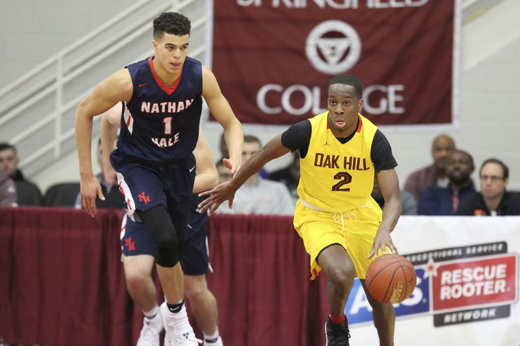 Matt Coleman (2) playing against Michael Porter and Nathan Hale High School at the Hoophall Classic.(AP Photo/Gregory Payan)