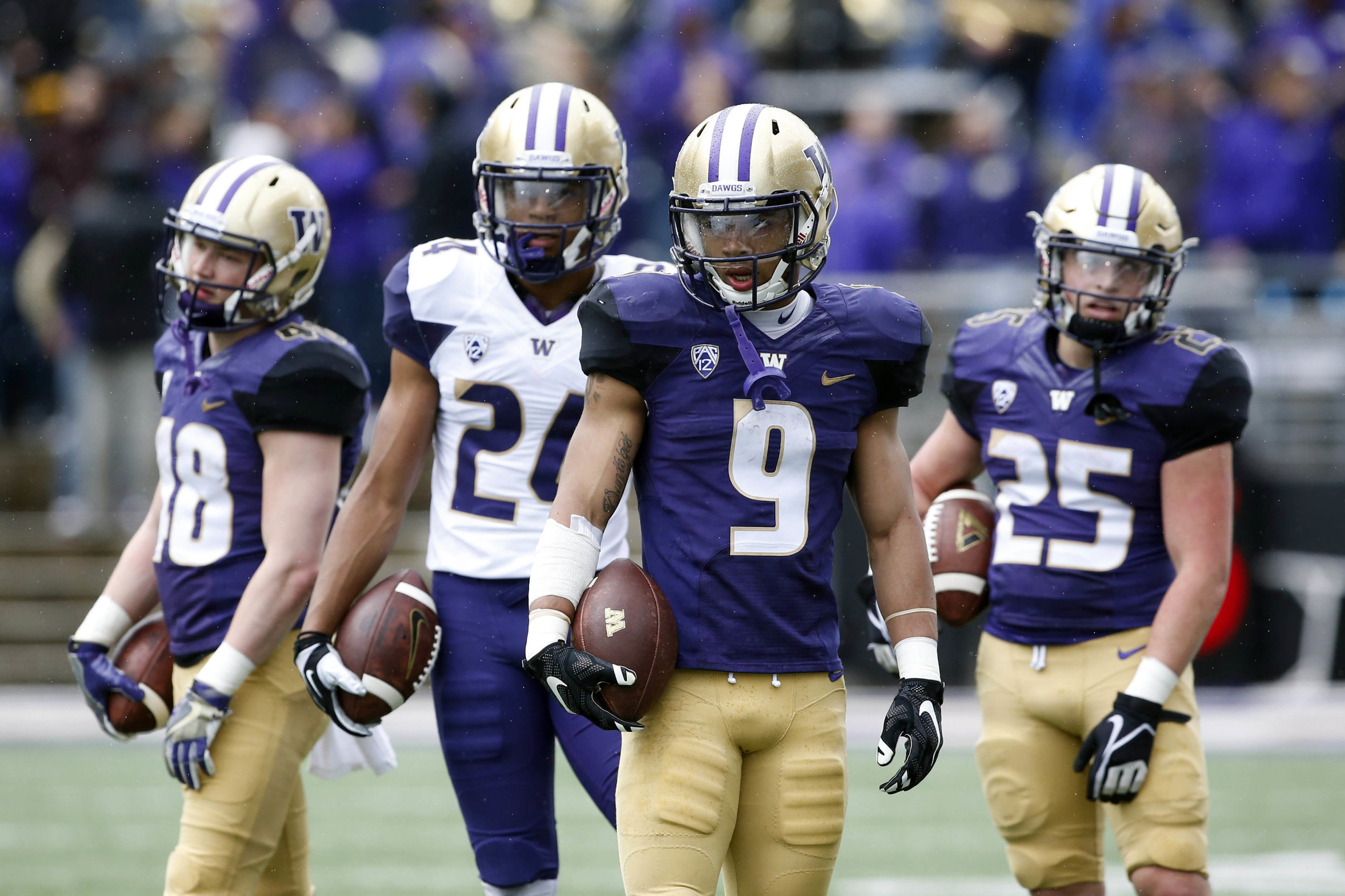 Myles Gaskins (9) has secretly been one of the top backs in the country the last two seasons. He is the x-factor for the Huskies long-term success this season. (Jennifer Buchanan/USA TODAY Sports)