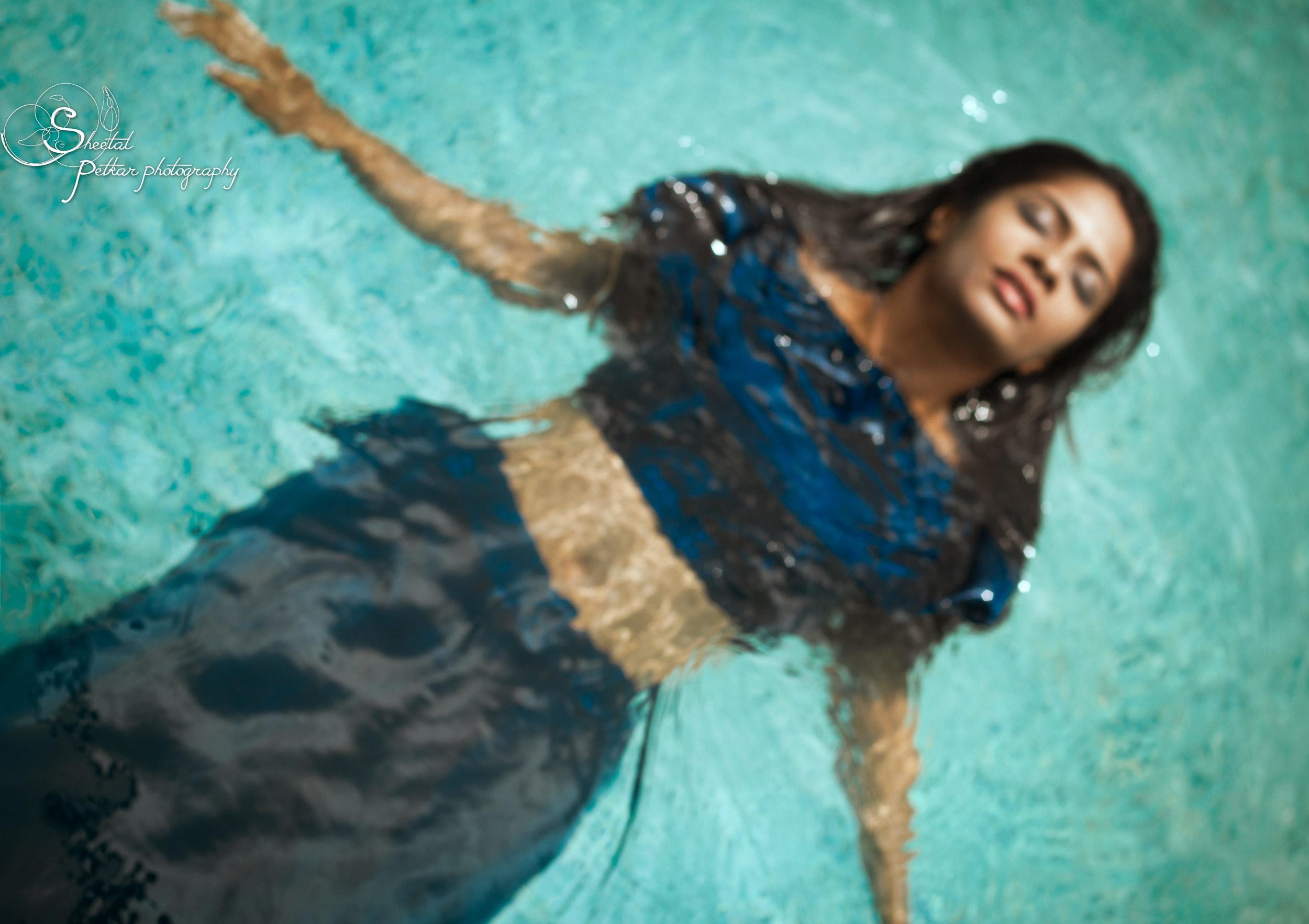 girl_in_blue_floating_on_water.jpg