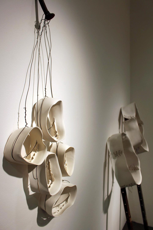 28. Karen Millar,  In Limbo , Porcelain, wire, rail spike, SOLD  29. Karen Millar,  Propped Up , Porcelain, nails, pickets, wire, $1,250