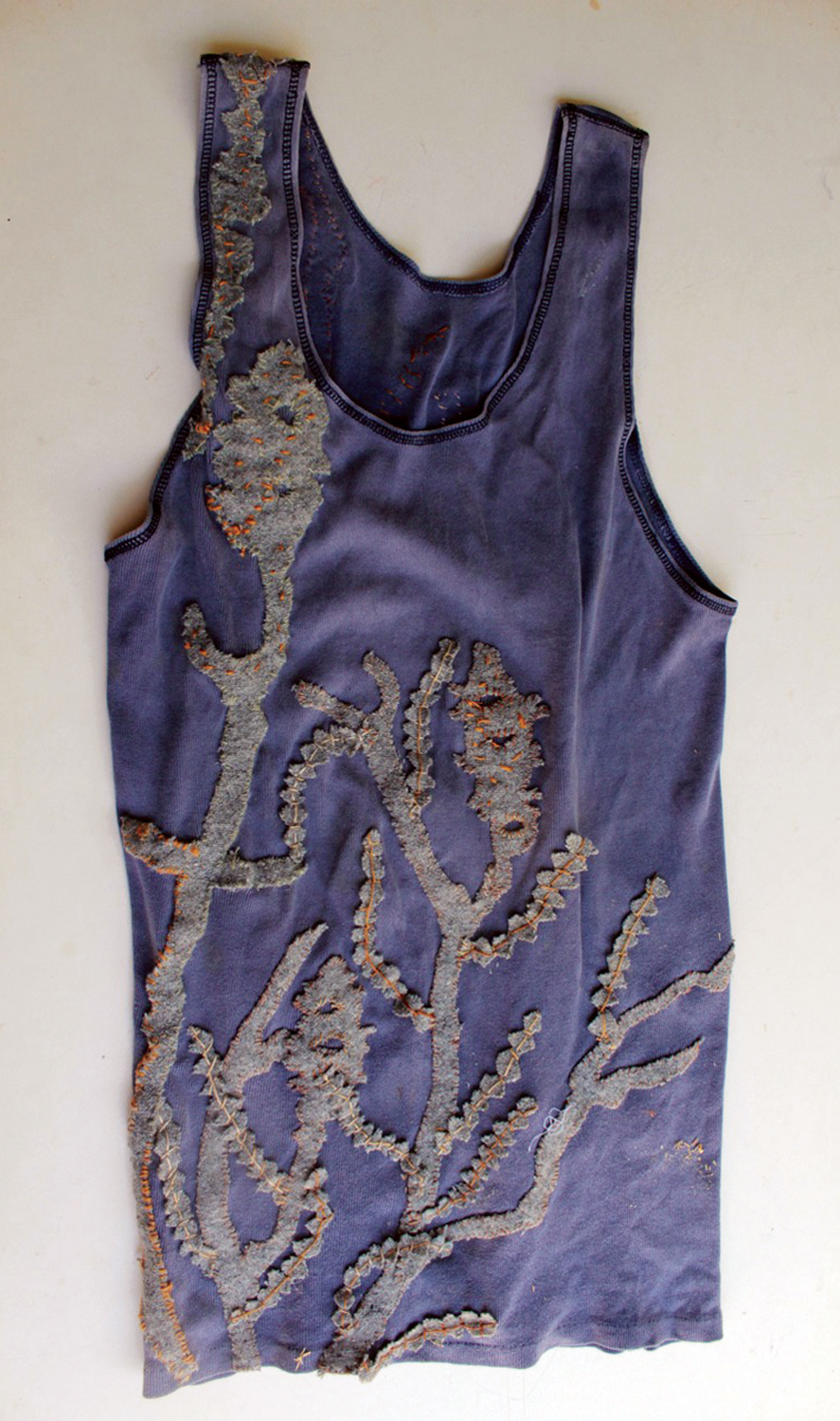 7. Nalda Searles,  Return , mans cotton singlet c.1998, grey blanket cut and stitched with linen thread, set with   The Shape Changers Slippers    $2,900