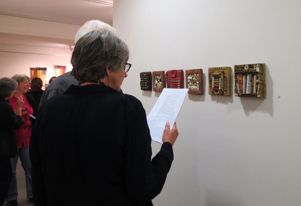 Exposition guests at the opening (work by Diane Savona)