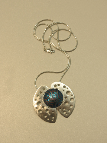 8.  Galaxies , sterling silver, niobium $215