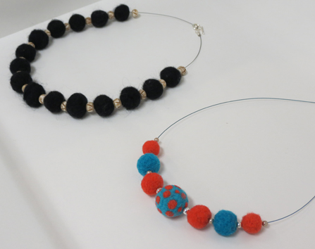 31.  Raven , synthetic fibre, merino wool, bone beads, sterling silver $235  32.  Fiesta , merino wool and sterling silver $235