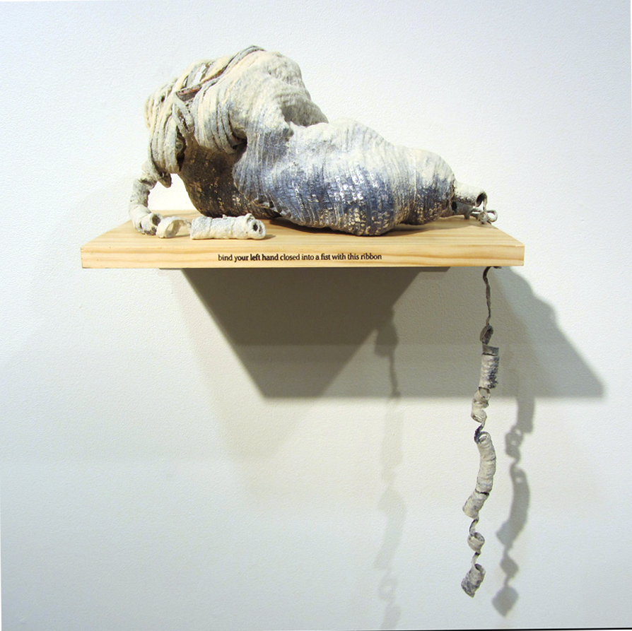 25.  bind your left hand closed into a fist with this ribbon  by Dani Andree mixed media $700