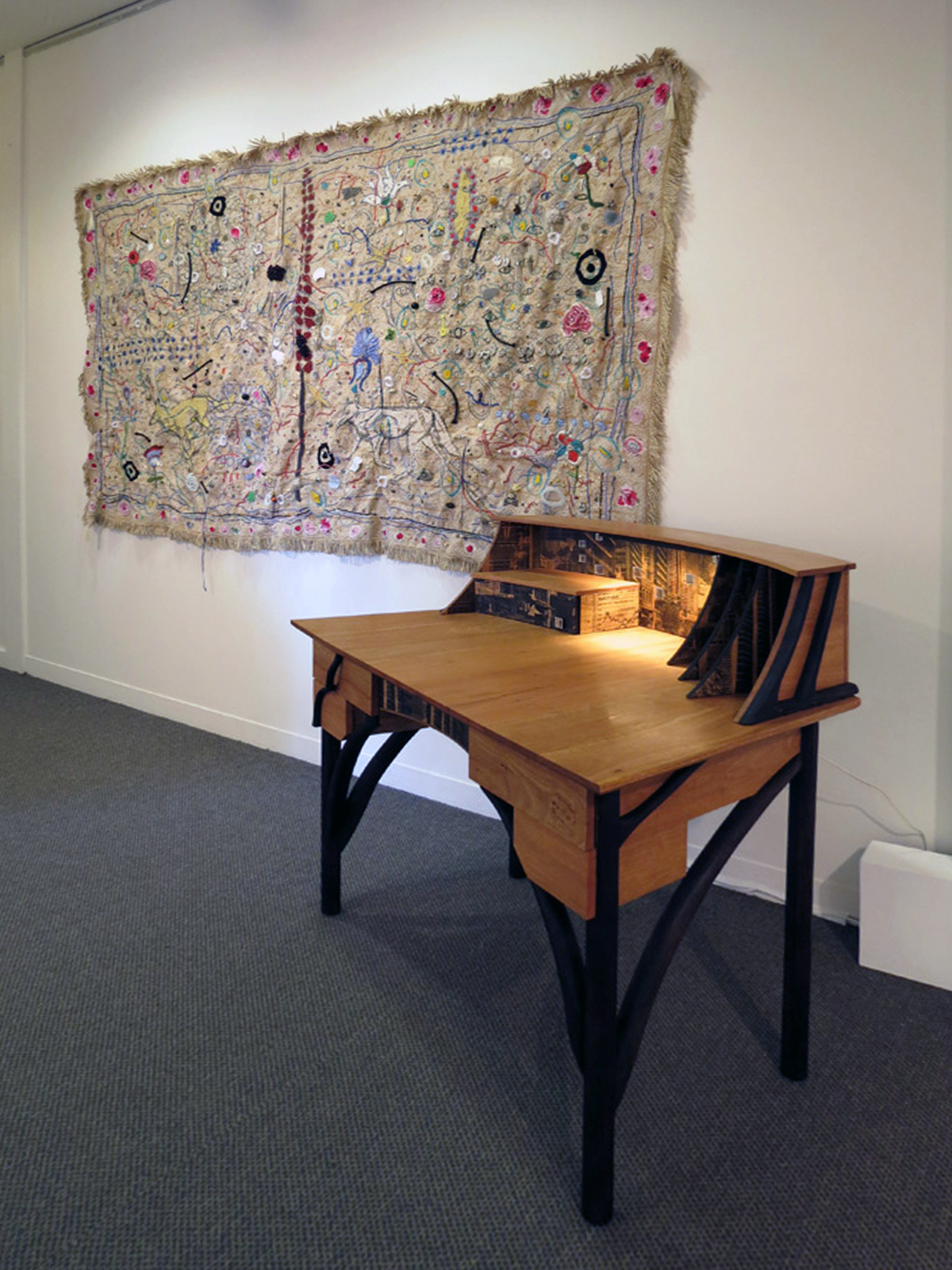 13.  I Am Filled With Objects , Susan Flavell, couch cover, mixed media, $5500  14.  Lost in the Wood , Megan Christie, Blackbutt, Marri, charred finish, screen printed veneer, cast copper figures, LED light, $6500