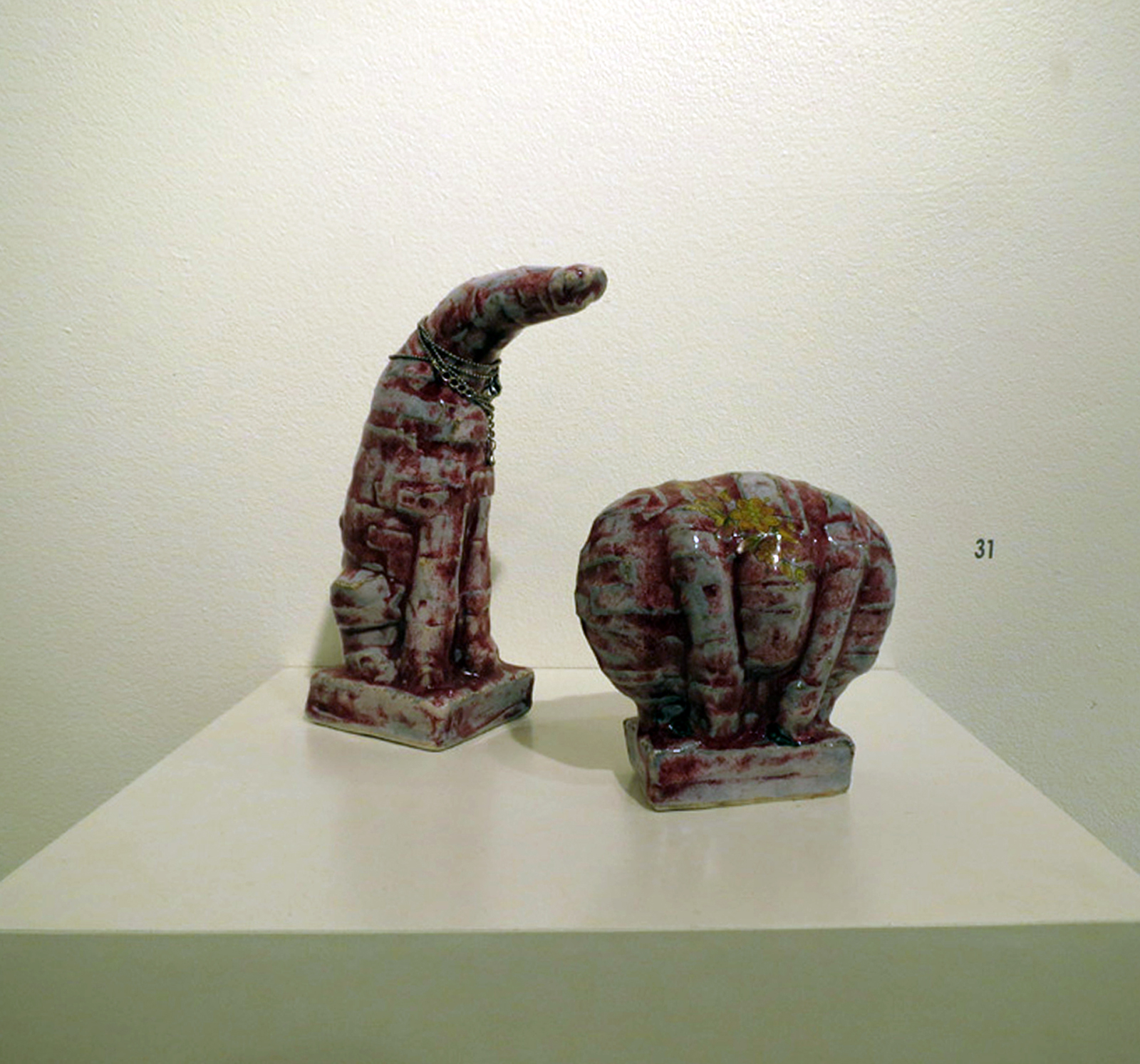 31.  Odd Couple , Susan Flavell, glazed press moulded stoneware, found chain, $550 pair