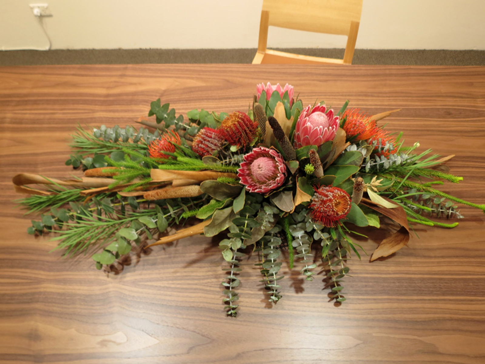 36.  Gerus Table , Adam Cruickshank, American Black Walnut, carbon fibre, $8,200  Flowers by Mundaring Florists By Design