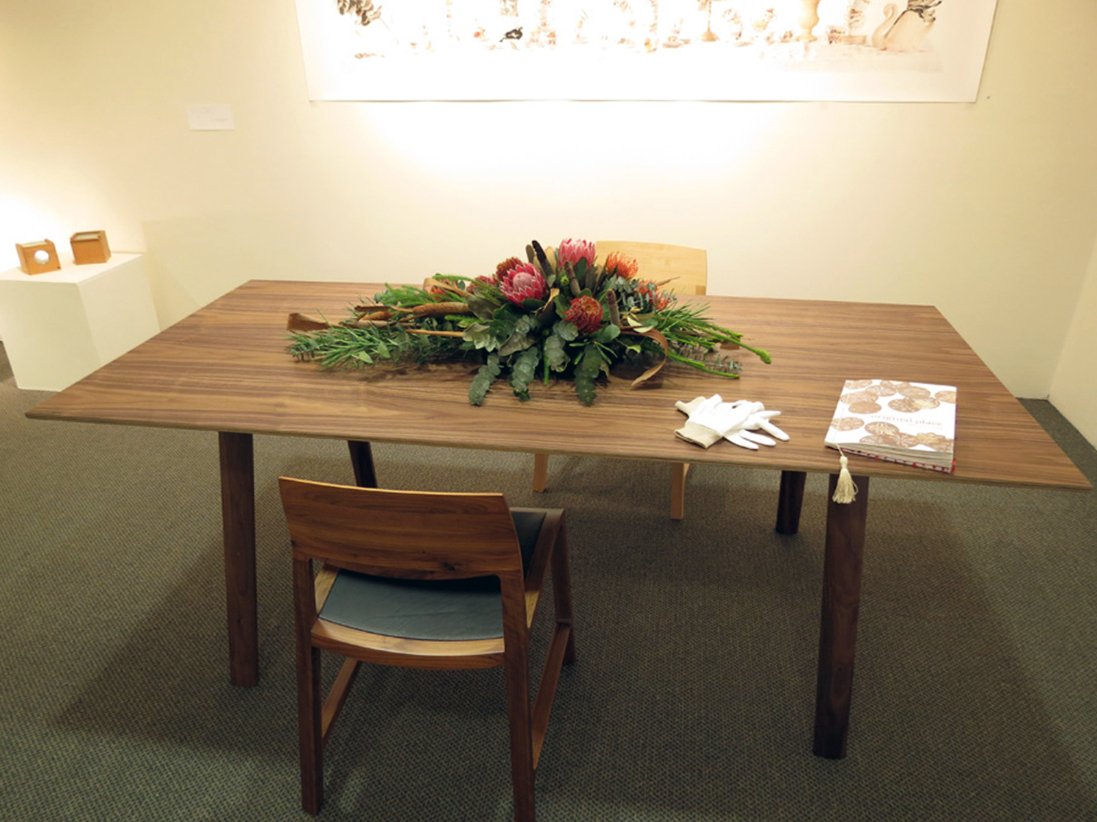 36.  Gerus Table , Adam Cruickshank, American Black Walnut, carbon fibre, $8,200  37.  Fletcher Chair , Adam Cruickshank, American Black Walnut, leather, $1300  Flowers by Mundaring Florists By Design