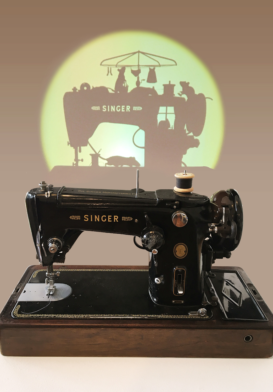 25. 'Of Mice and Hems', Tee Ken Ng, 1955 Singer Sewing machine, digital projector, looped animation, $3,000