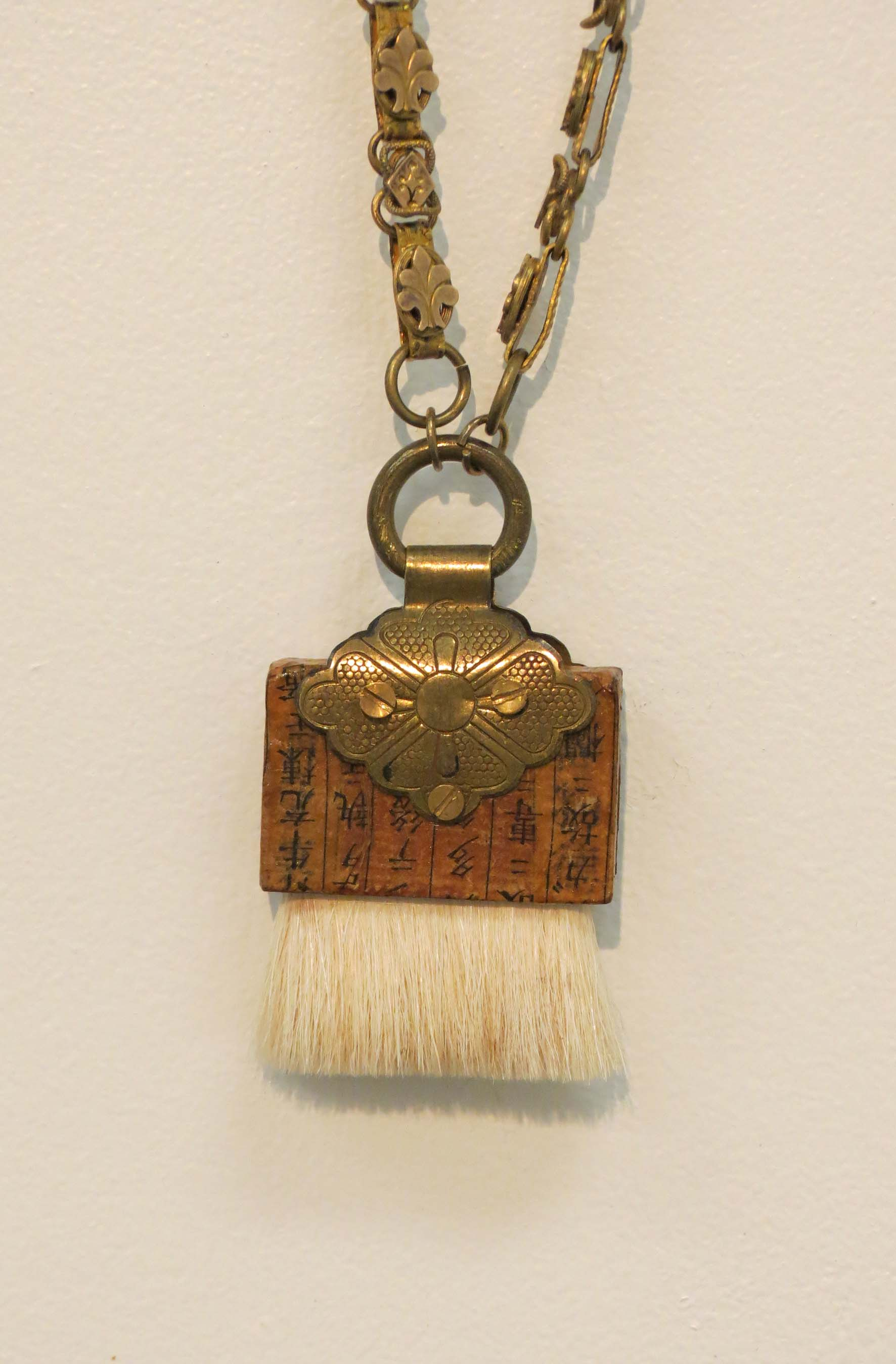 10. Kathy Aspinall, 'Brush I', 2018, wooden brush, brass, Japanese paper, antique chain, necklace, $295
