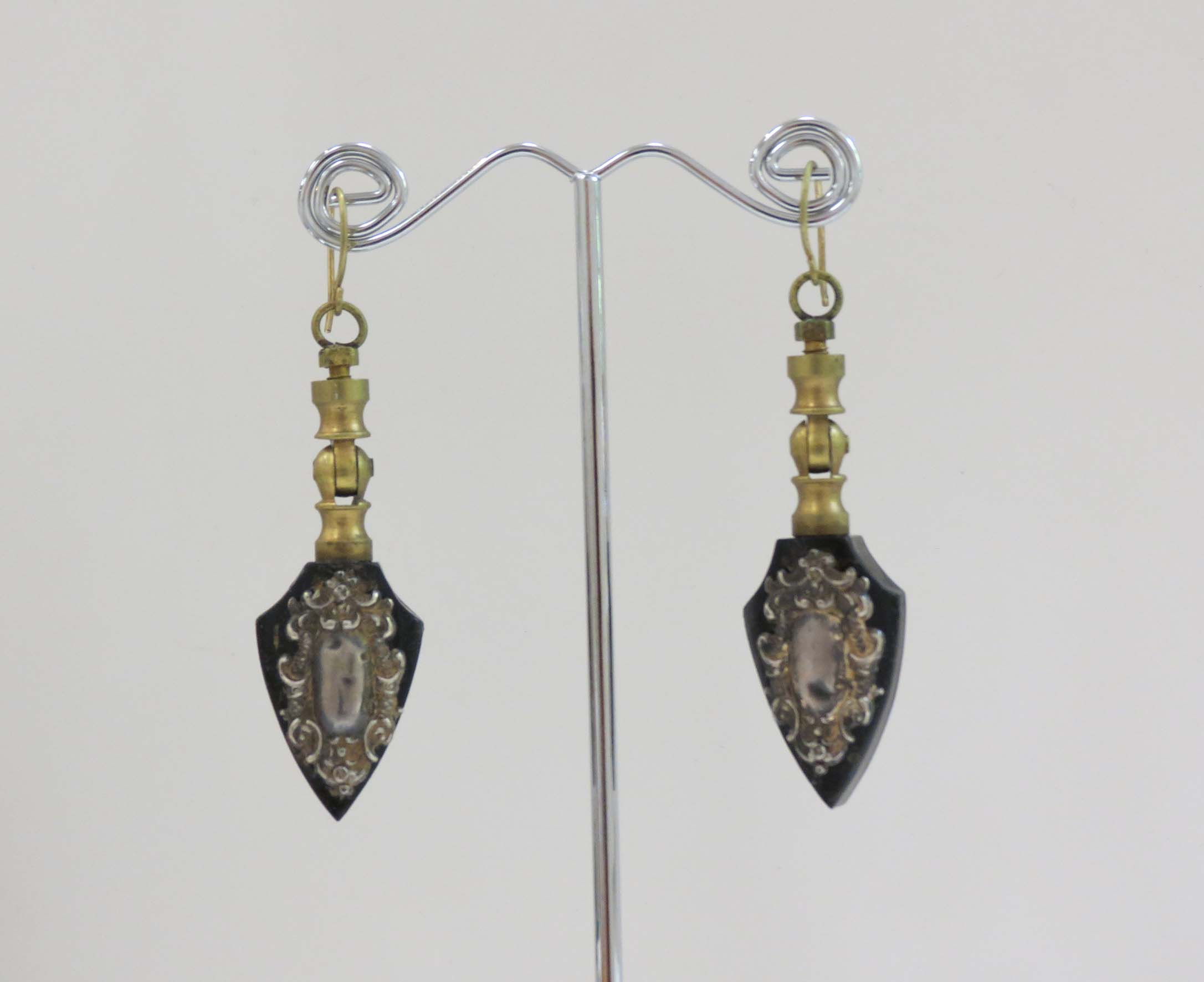 16. Kathy Aspinall, 'Pull', 2018, vintage drawer pulls, antique paper, silver, earrings, $270 blurry
