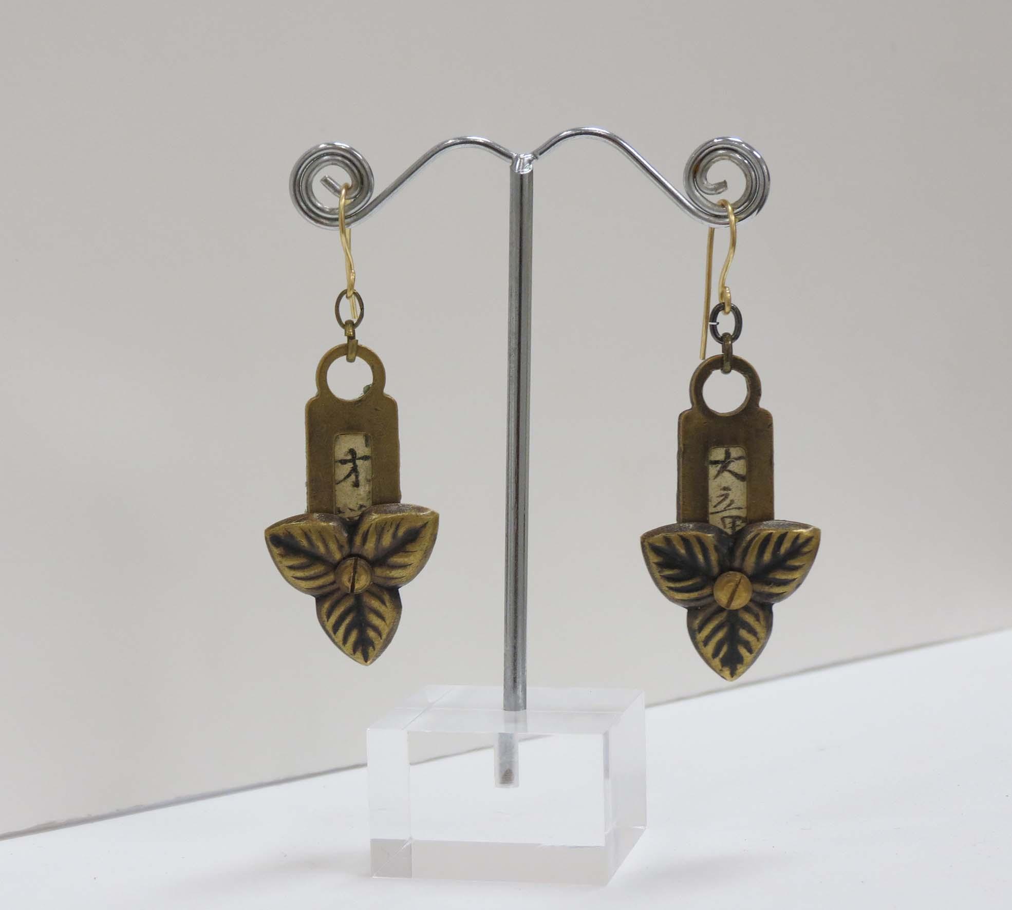 18. Kathy Aspinall, 'Brass', 2017, brass, Japanese paper, resin, earrings, $175