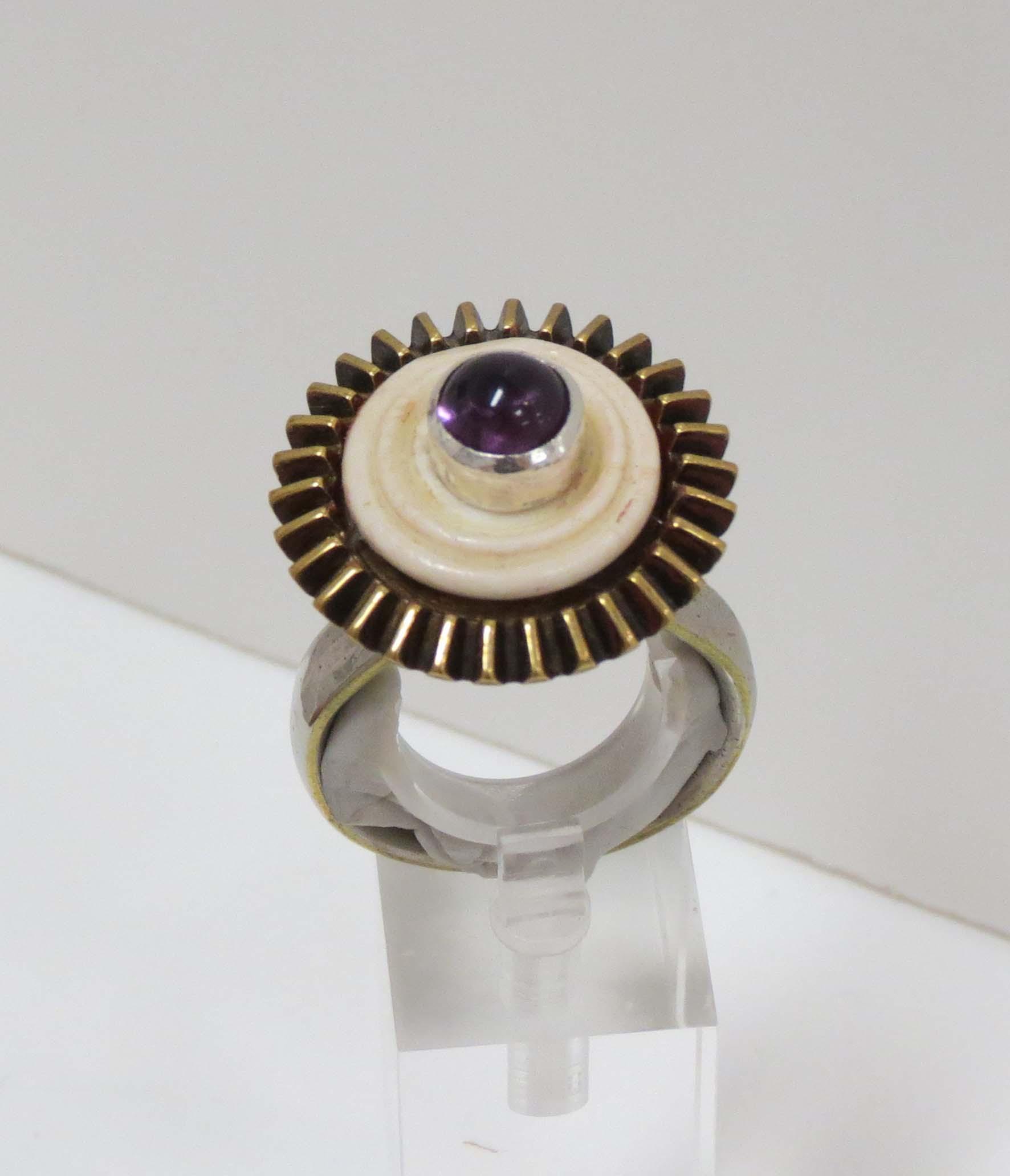 25. Kathy Aspinall, 'Royal Cog', 2018, steel, brass, bone, silver, amethyst, Man's ring (size Z), $300