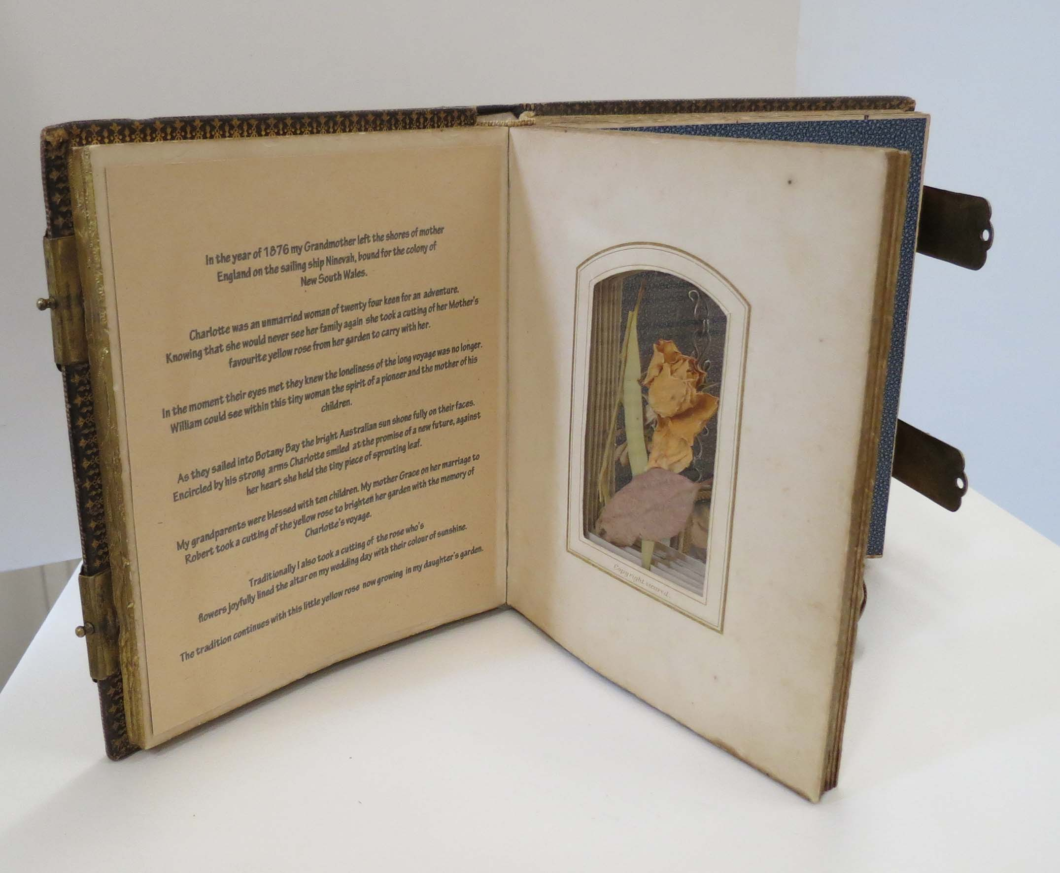 31. Kathy Aspinall, 'Charlotte's Rose', 2012, Victorian photograph album, personal ephemera, brass, story necklace, altered book, $1,200
