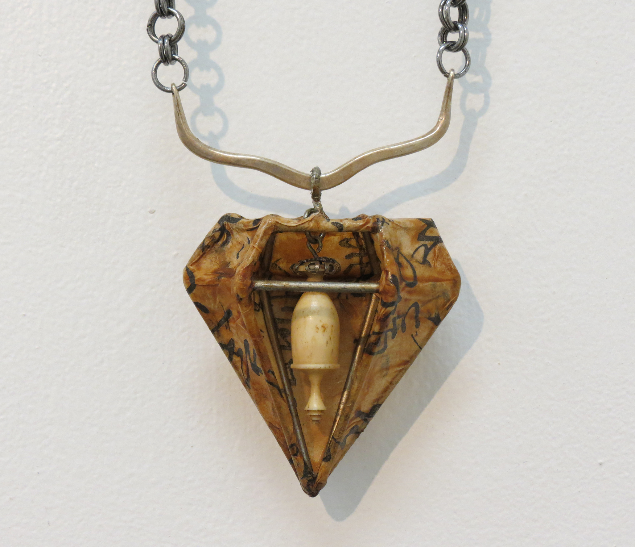 8. Kathy Aspinall, 'Ivory', 2017, steel, silver, antique Japanese paper, antique ivory, necklace, $300.jpg