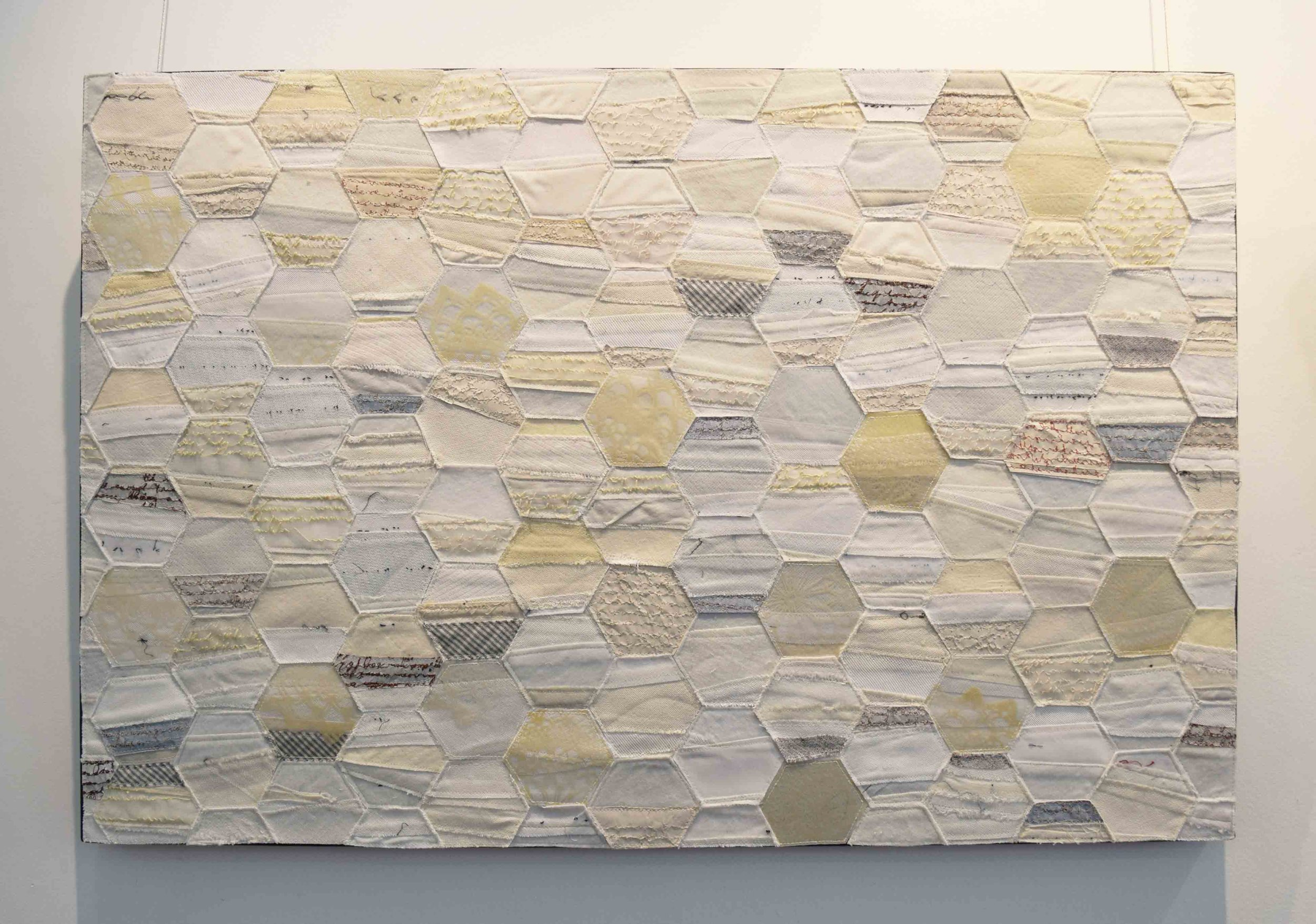 4.  2000 Miles Away 1 , 2018, business tie facings, hand woven silk organza, overhead projector sheeting, recycled security envelopes, 61 x 91 cm. $1,500 each
