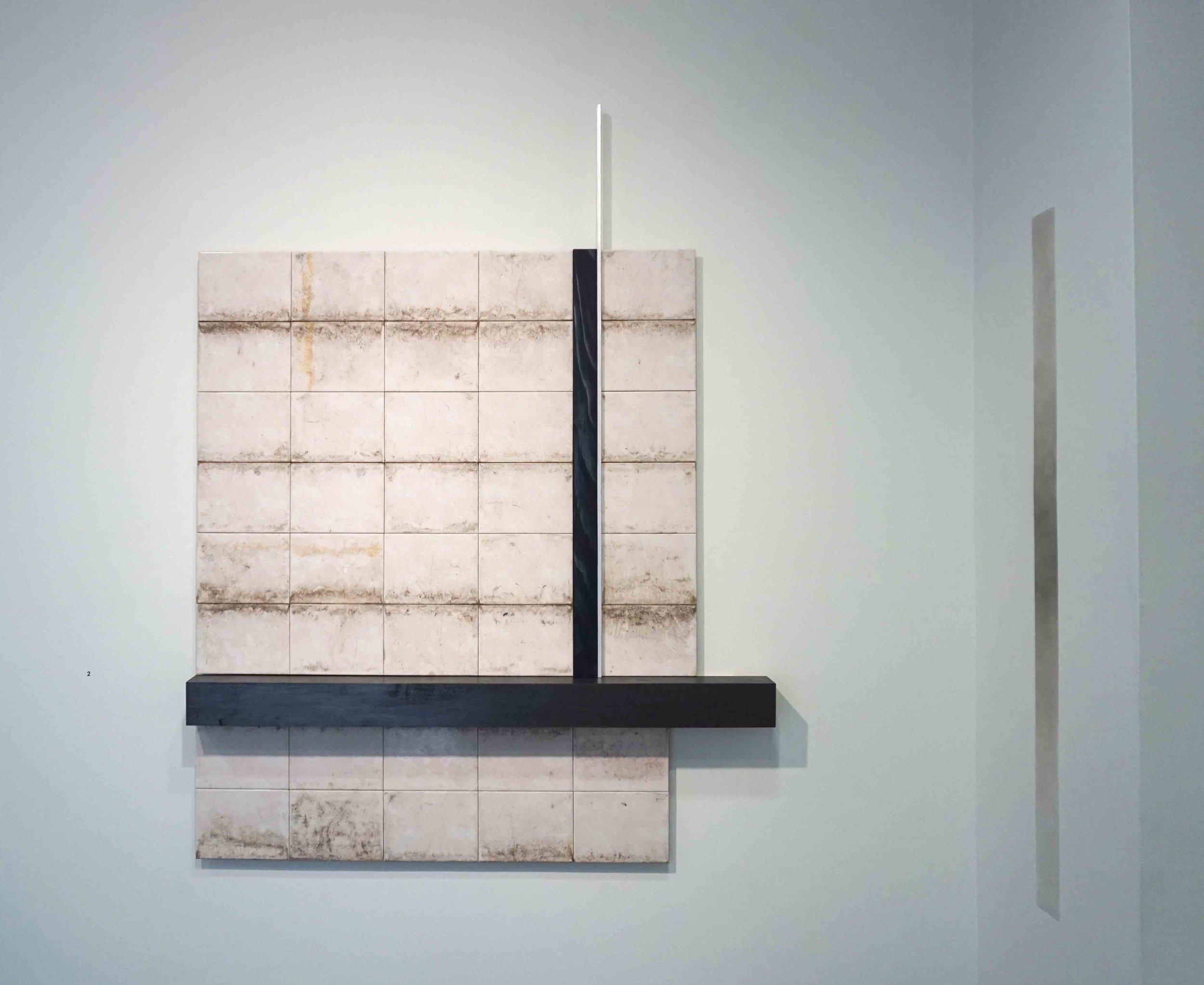 2. Penny Coss and Benjamin Bannan, P arallel States , 2019, ceramic tiles, wood, mica powder, graphite powder, ash and indigo pigment on aluminium, 130 x 120 cm $1,800