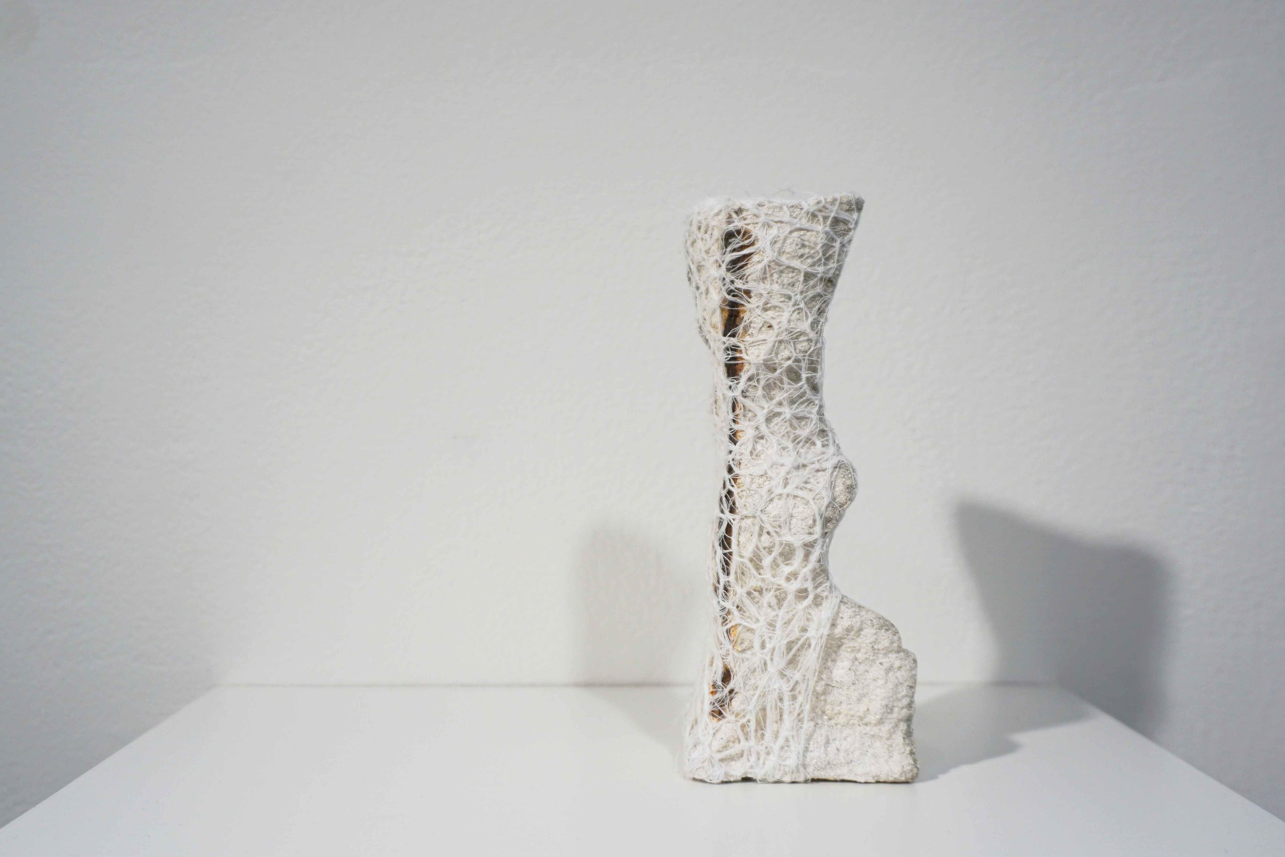 13. Melanie Dare,  Mending broken boundaries series  (l), 2019, concrete fence pillar, gauze and thread, dimensions variable, $560 or available for $3,300 as a series