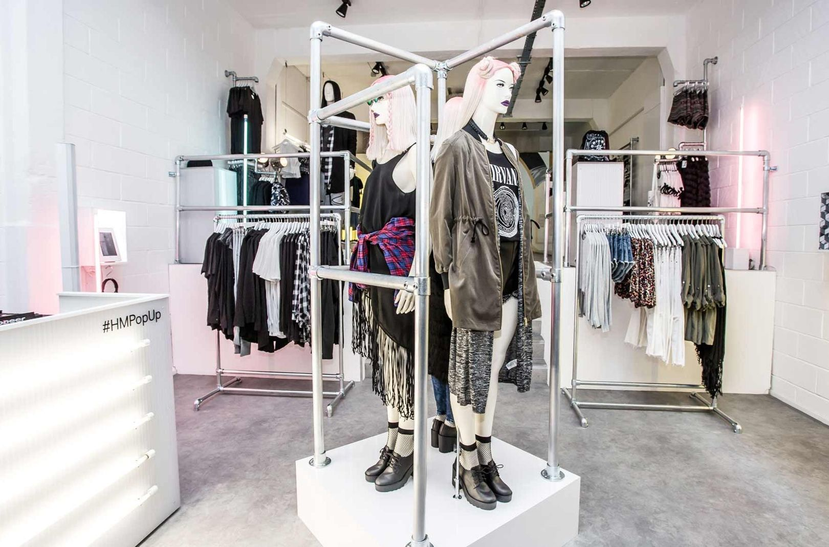 H&M's Brick Lane DIVIDED pop up store was created with an industrial vibe, with a separate music area for customers to listen to curated playlists. Image credit:  GQ