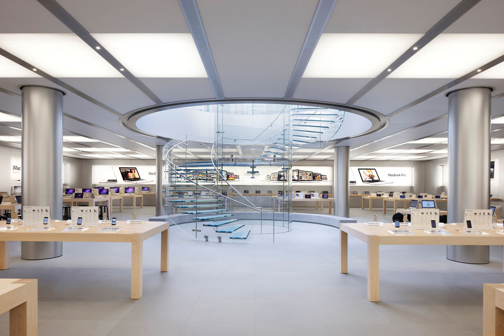 Apple Store Design. Apple uses a lot of white light and presents its products with a lot space between them. The design of the products is replicated in the pure and clean store design.