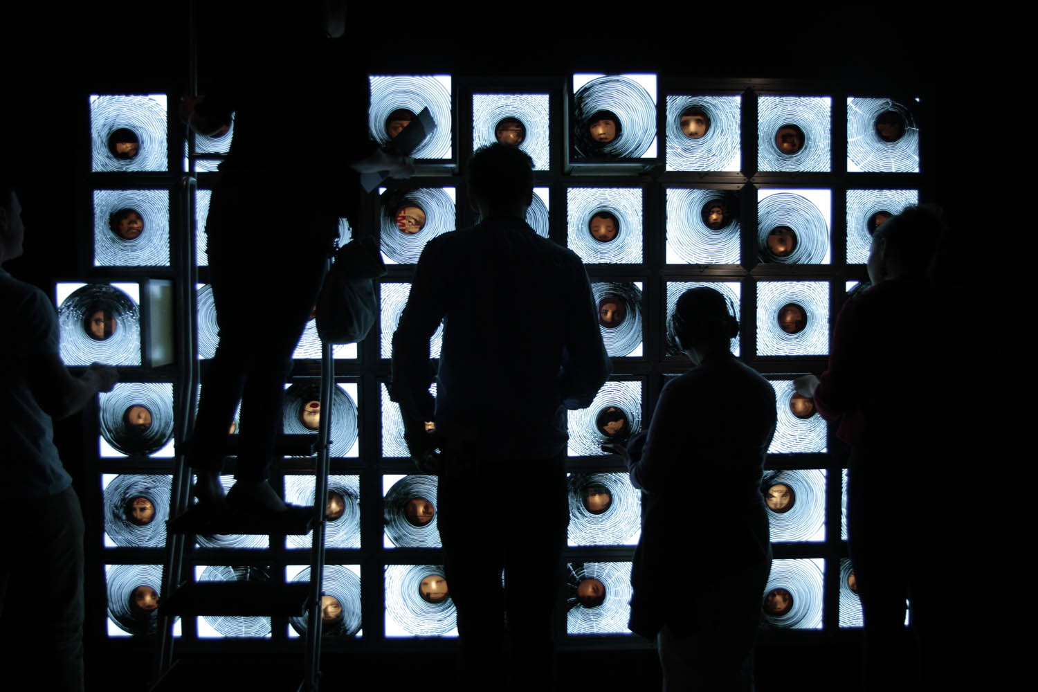 "Visitors to the Museum of Old and New Art (MONA) in Hobart, Australia, interact with a piece of art. Each section of the piece pulled out like a drawer, and a different voice would repeat ""I love you."""