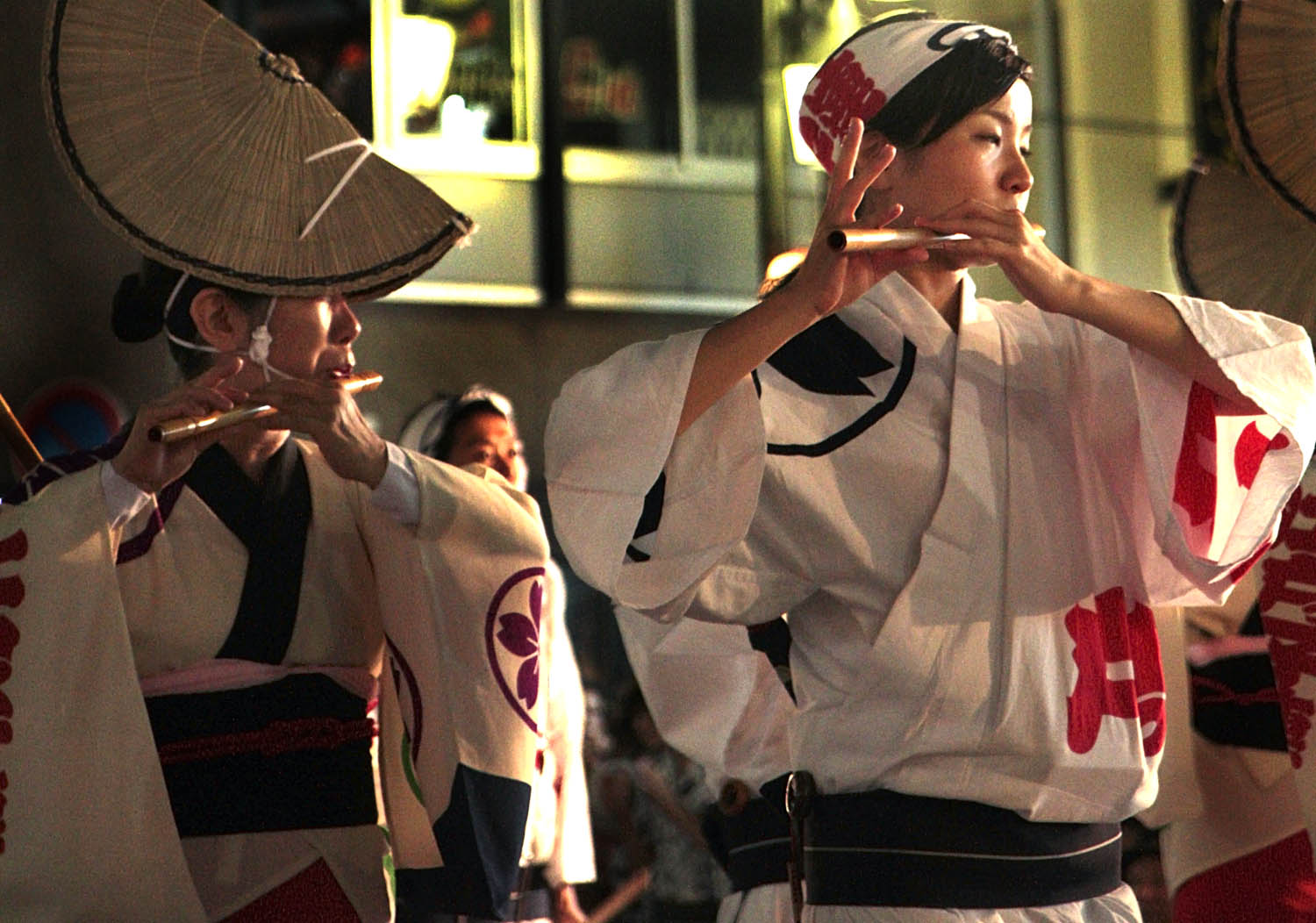 Performers play the shinobue flute, a traditional Japanese instrument.