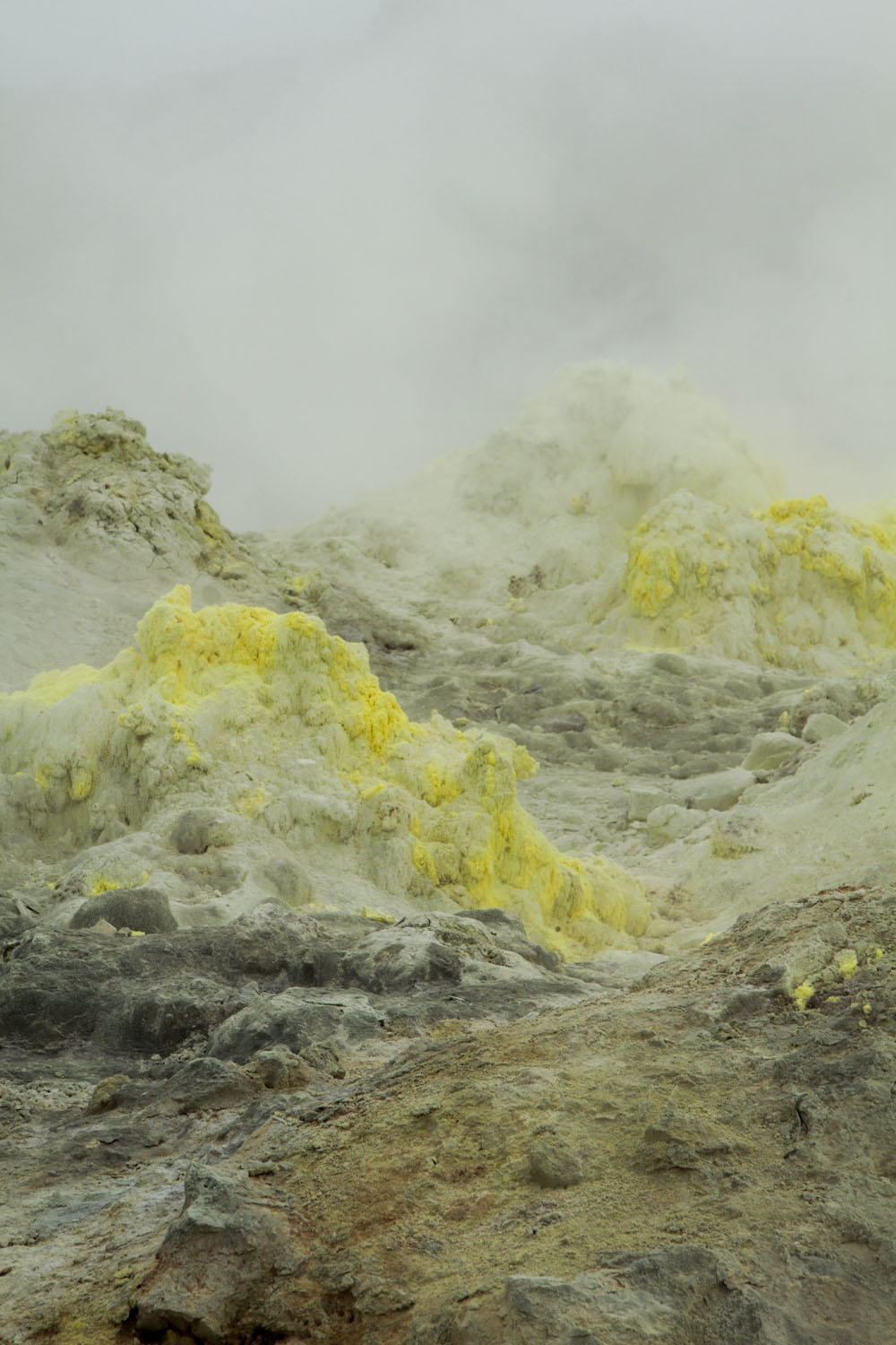 Iozan, a mountain in Hokkaido, constantly emits sulfur gas, creating these yellow formations.
