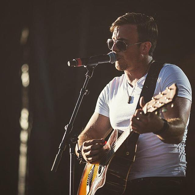 Eric Ethridge  - winner of Boots and Hearts upcoming artist 2015 wearing some  Bear  (HEN Jewelry's mens line) onstage