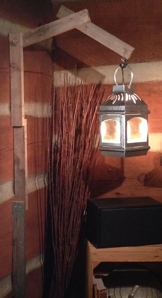 "Electric lantern  - made this from a $10 candle lantern that I wired with a switch and light bulb. The ""post"" parts are reclaimed wood I salvaged from an old house in North Georgia that had collapsed many years ago."