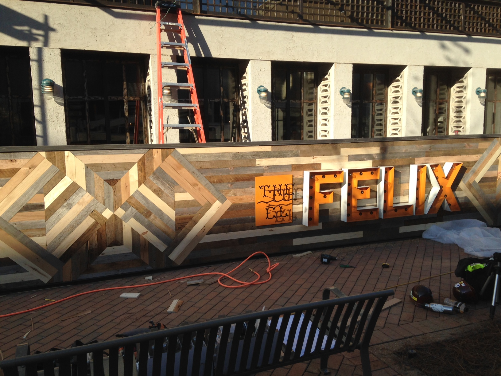 "The EL FELIX (Alpharetta, GA)- Opening in Winter 2014. The steel frame was fabricated by another contractor. We sheeted it in plywood then laid out the pattern and filled in with aged 1/2""oak strips in different patinas. Over 1500 linear feet of wood makes up the 35' sign."
